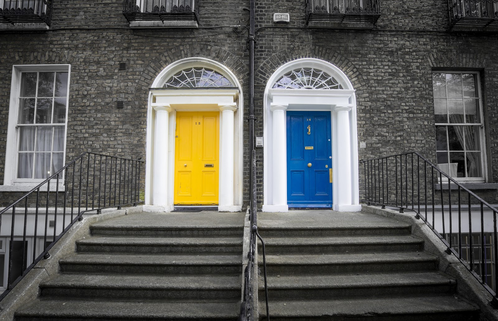 Yellow and blue doors beside each other