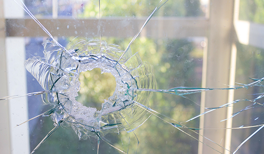 Close up of a broken window with cracked glass