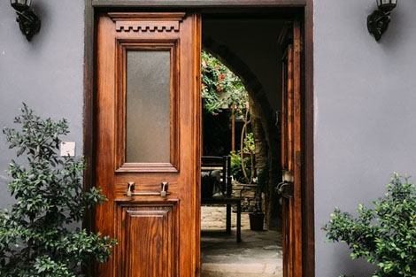 Wooden front door with two outdoor lights