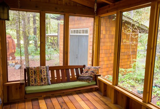 Screened-in porch idea with suspended swing