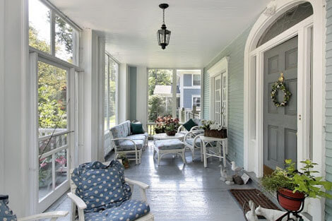 Screened porch with a sitting area