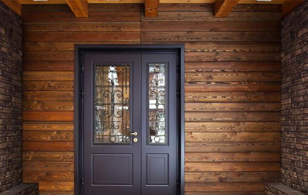 Steel door set against wooden walls