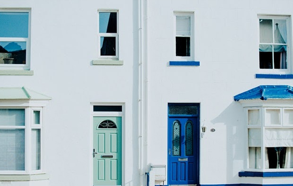 Houses with turquoise and blue door