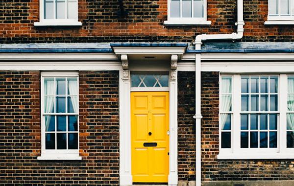 Bright yellow fibreglass door