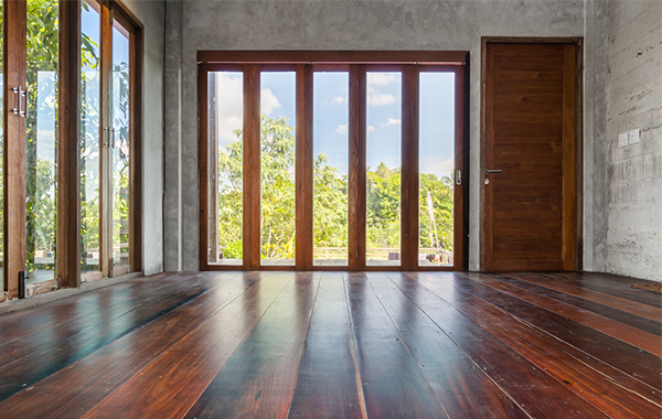 Wooden floorboards and wooden-framed folding doors