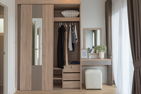 Modern closet doors open up to an organized closet
