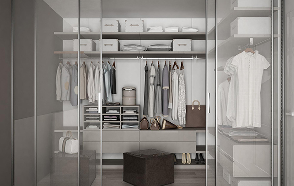 A neatly organized open-concept walk-in closet with shelves and drawers