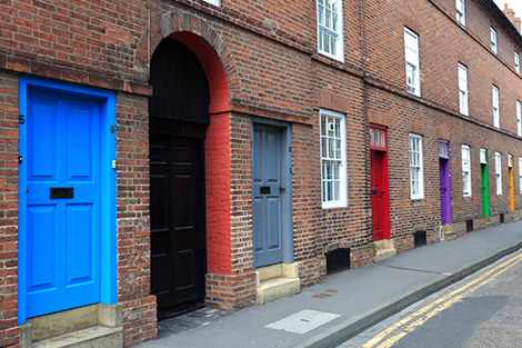 A row of colourful front doors