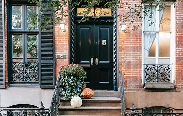 Black front door with spiral columns