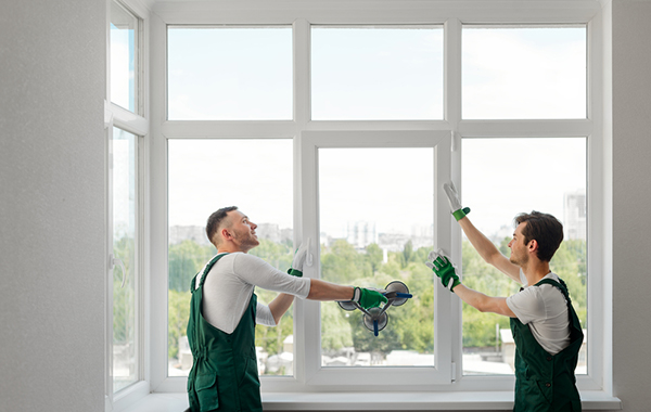 Two professional window installers