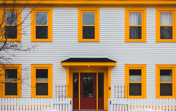 House with bright yellow window frames