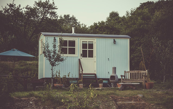 Tiny house with powder blue walls