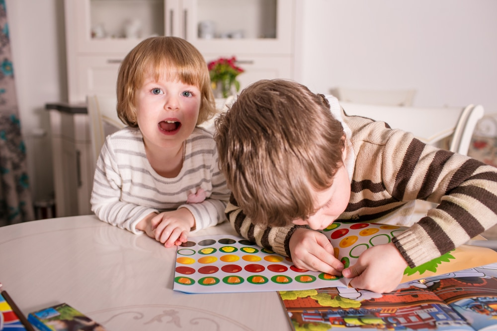 Kids playing with stickers