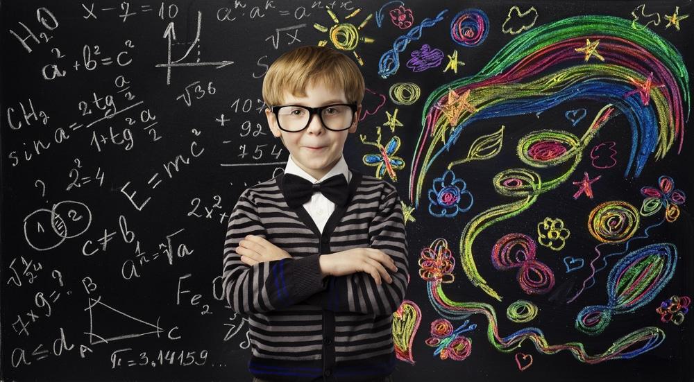 Little boy behind blackboard