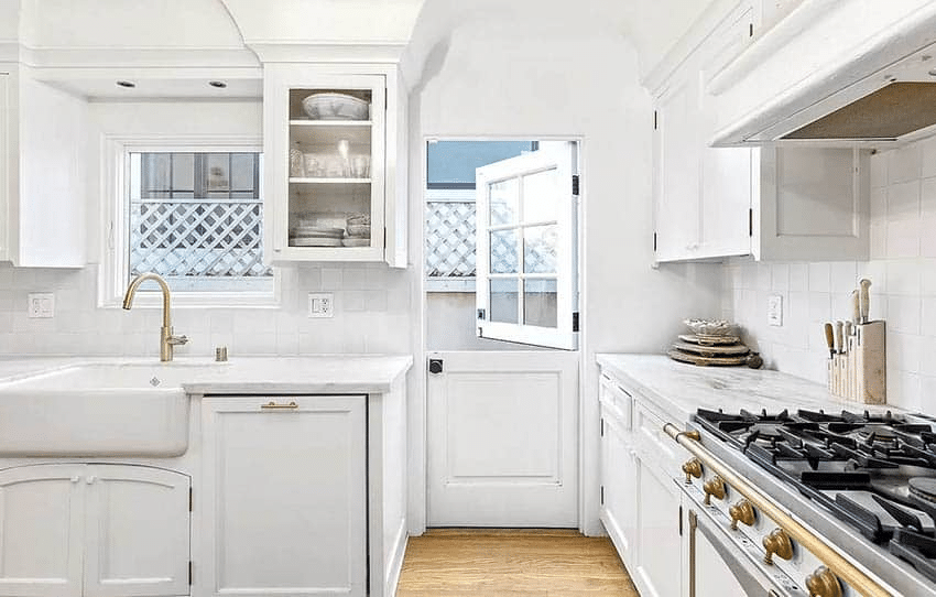 A white Dutch door used as a kitchen's backdoor