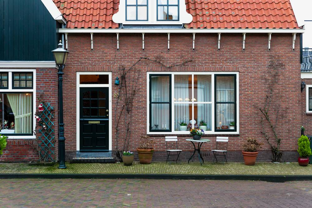 Facade of a classic home with a stylish, black Dutch door