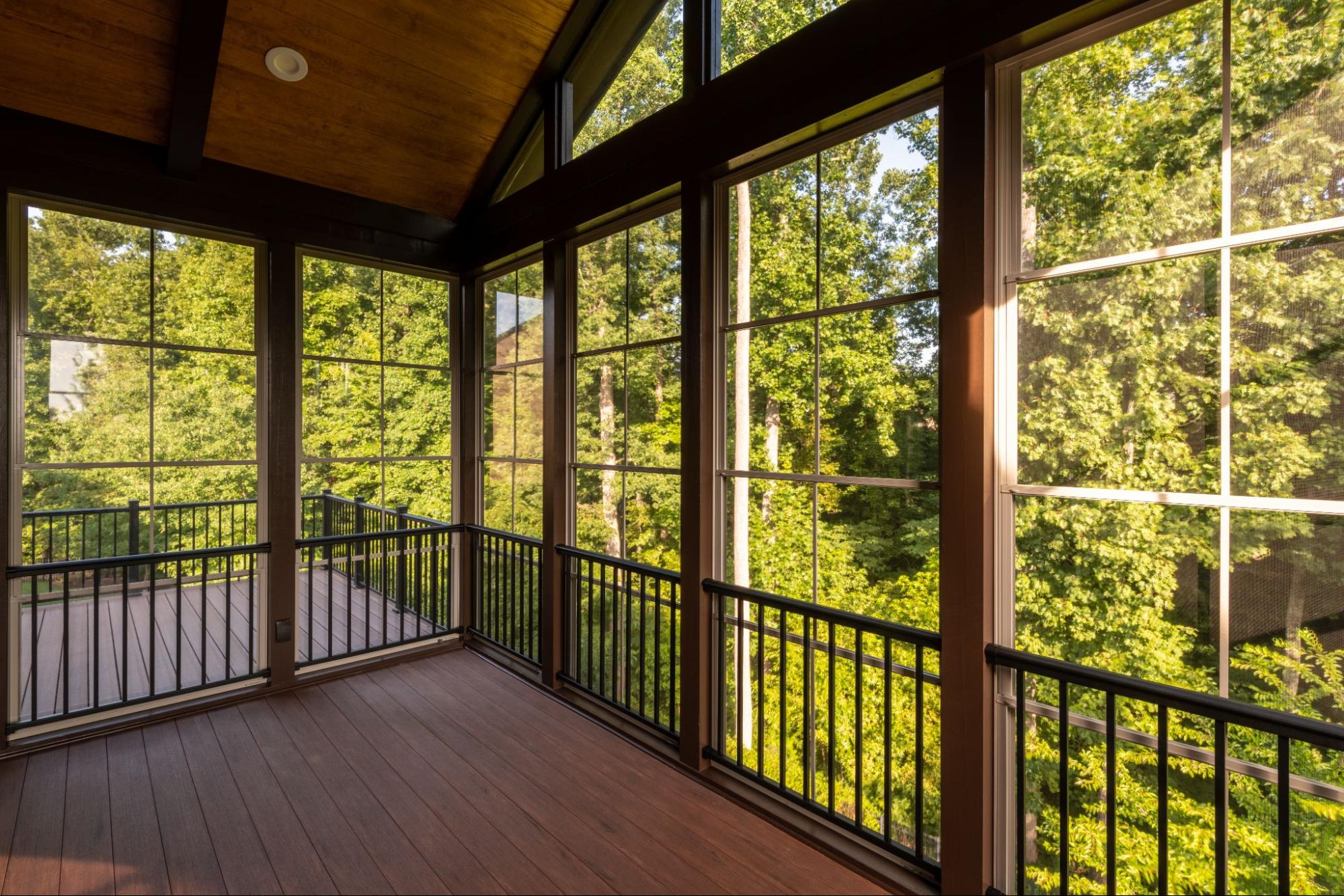 Porch enclosure Toronto with large glass panels