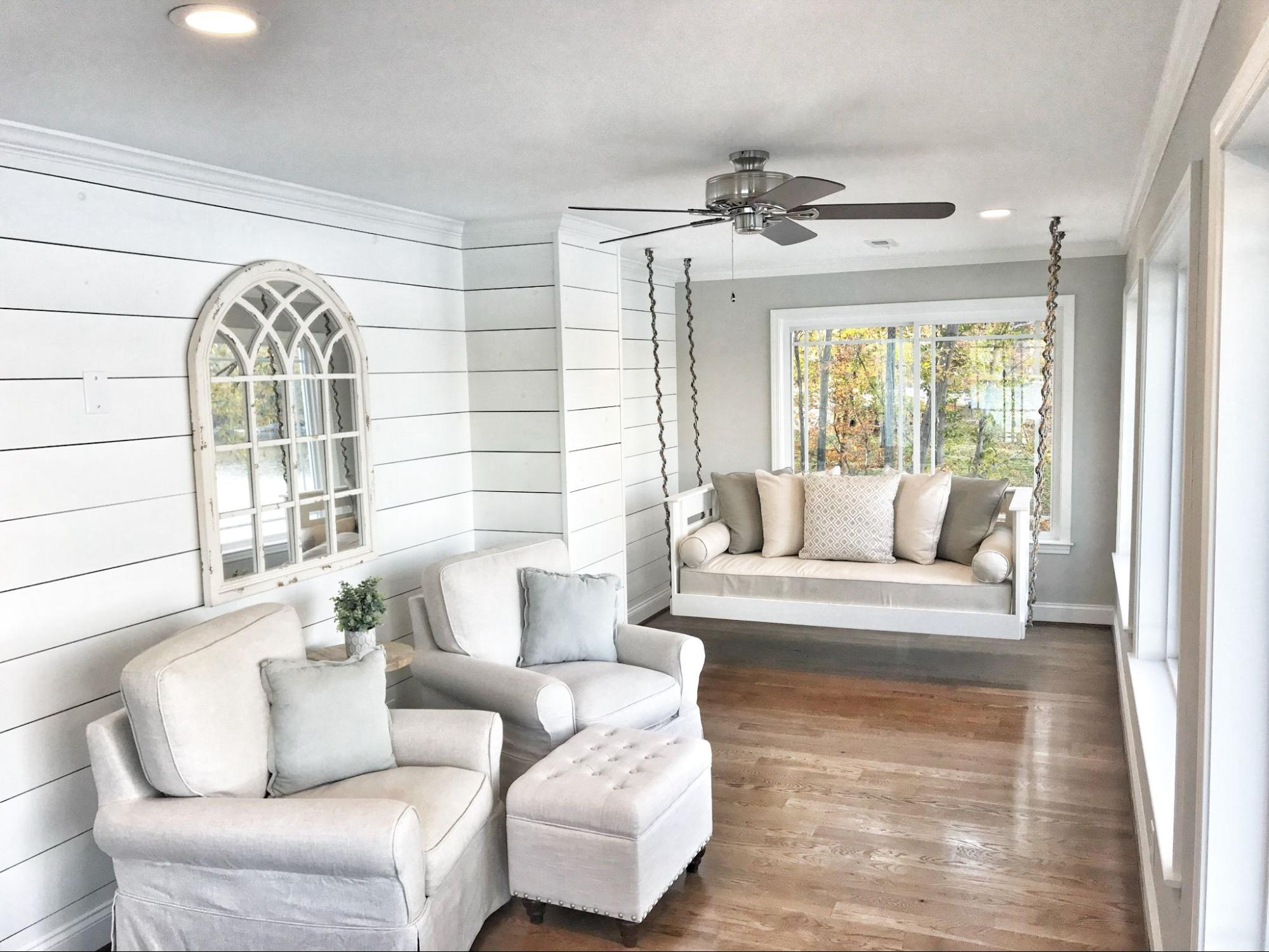 A porch enclosure Toronto with white furniture
