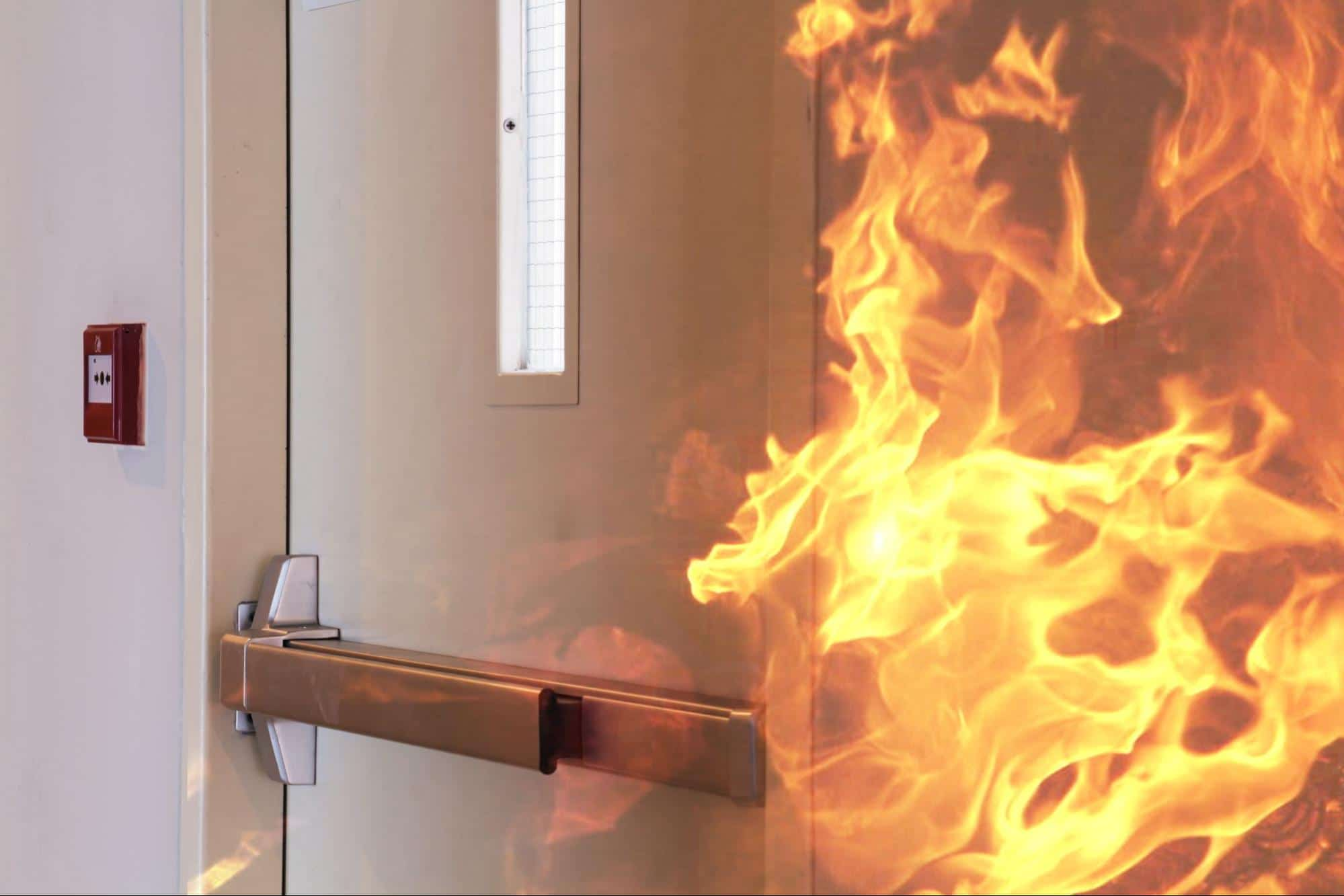 A fire burning behind a closed fire-rated door